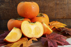 Stack of fresh Persimmons Stock Photo