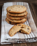 Stack of Freshly baked chocolate chip cookies. Freshly baked chocolate chip cookies on fabric stock photography