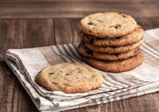 Stack of Freshly baked chocolate chip cookies. On fabric royalty free stock image
