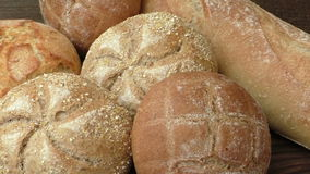 Stack of freshly baked homemade bread buns stock footage