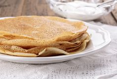 Stack of freshly homemade crepes stock images