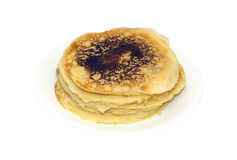Stack of fried pancakes in white plate isolated Royalty Free Stock Photography