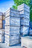 Stack fruit boxes or crates sit outside a warehouse Stock Photos