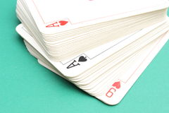 Stack of game cards on green background Stock Photos