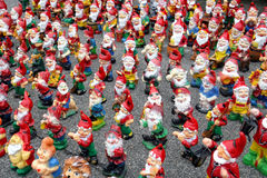 Stack of garden gnomes. Stack of garden happy gnomes royalty free stock photography
