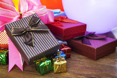 Stack of gift box lying on top wood table Royalty Free Stock Image
