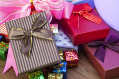 Stack of gift box lying on top wood table use for gift festival Royalty Free Stock Photography