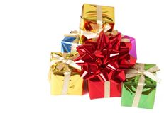 Stack of gift boxes and bow on white Royalty Free Stock Photography