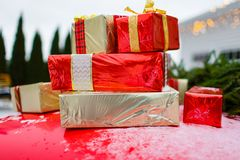 Stack of gift boxes put on red surface. Festive mood royalty free stock photos