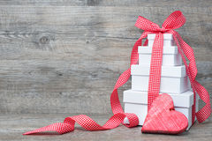 Stack of gift boxes with ribbon and bow Stock Photos