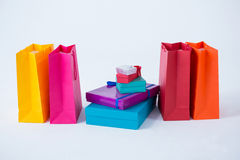Stack of gift boxes with shopping bags Stock Images