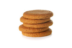 Stack of ginger nut biscuits on a white background. Stack of biscuits on a white background Stock Photos