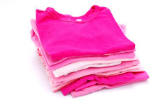 Stack of girls clothes. A stack of freshly washed and ironed pink girls clothes. Image isolated on white studio background Stock Photography