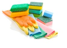 Stack of glowes rags and sponges. Isolated on white background Stock Image