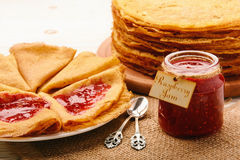 Stack of gluten free pancakes made from corn flour served with raspberry jam. Royalty Free Stock Photography