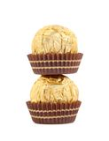 Stack of gold chocolate bonbons. Royalty Free Stock Image