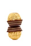 Stack of gold chocolate bonbons. Royalty Free Stock Photography