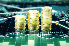 Stack of gold coins on business chart Royalty Free Stock Images
