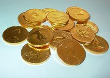 Stack of gold ounces Canada Maple Leaf Elizabeth II royalty free stock photos