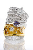 Stack of gold rings with diamonds and sapphire Stock Photography