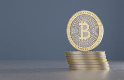 Stack of gold and silver bitcoins as example for crypto-currency in front of blurred blue background Stock Photos