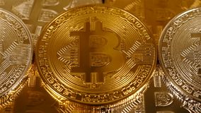 Stack of gold and silver bitcoins stock footage