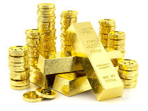 Stack of golden bars and coins Royalty Free Stock Images
