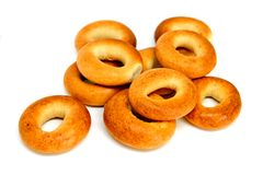 Stack of a golden brown bagels in a variety of flavors stock images