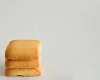 Stack of golden brown biscuits Stock Photography