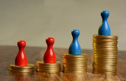 Stack of Golden Coins Graph going up with pawns Royalty Free Stock Photos