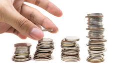 Stack of golden coins and human hand Royalty Free Stock Image
