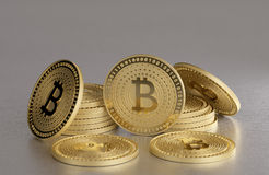 Stack of golden coins on metal floor as example for virtual crypto currency, bitcoin and blockchain technology Royalty Free Stock Image