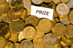 Prize sign at a stack of golden coins Royalty Free Stock Photos