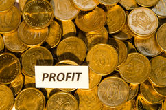 Profit sign at a stack of golden coins Stock Images
