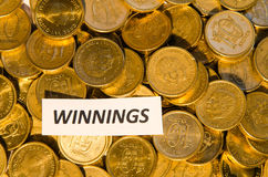 Winnings sign at a coin stack Stock Photos