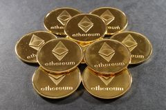 Stack of golden ethereum coins. Cryptocurrency background image. Royalty Free Stock Photo