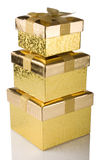 Stack of golden gift boxes Royalty Free Stock Photo