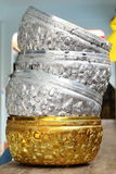 Stack of Golden and Silver Bowls. In Thai culture, these use for Buddhist ceremony Stock Image