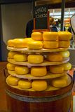 Stack of gouda cheese in a store stock images