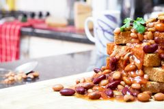 A Fully Loaded Stack of Beans on Toast in a Kitchen and Ready to royalty free stock photos