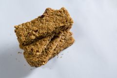 Stack of granola bar on white background Royalty Free Stock Images