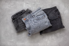 Stack of gray jeans Stock Photography