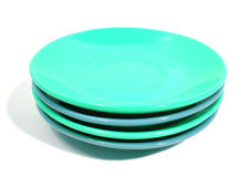 Stack of green and blue plates on white background Stock Photo