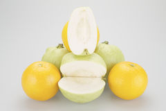 Stack of green guava and yellow orange Royalty Free Stock Image