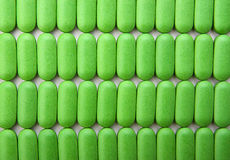 Stack of green pills Royalty Free Stock Photo