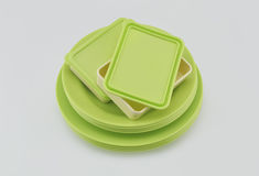 Stack of green plastic plate and dish  on white Stock Image