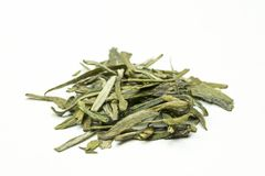 A stack of green tea leaves with tips on a white background Royalty Free Stock Images