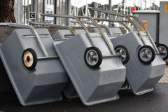 Stack of grey carts. A stack of carts made of grey plastics on metal frame with one axle Stock Images