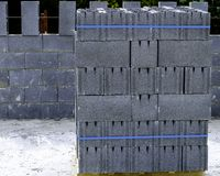 Stack of grey clay brick on pallet. Of a terace Royalty Free Stock Photography