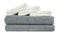 Stack of grey and white bath towels. Isolated over white Royalty Free Stock Photography